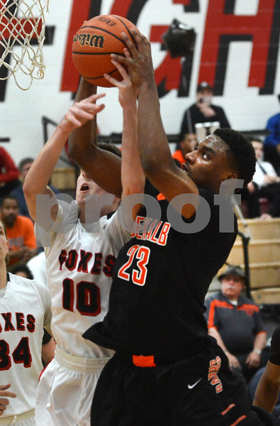 DeKalb junior Marcus Bobo pulls down a rebound during the Barb's game against Yorkville Friday, Feb. 24 at Yorkville High School.<br /> Mark Busch - mbusch@shawmedia.com