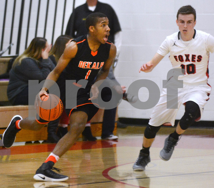 DeKalb senior Michael Mitchell tries to get past Yorville's Jake Eberhart during their game Friday, Feb. 24 at Yorkville High School.<br /> Mark Busch - mbusch@shawmedia.com