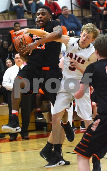 DeKalb junior Marcus Bobo gets tangled up with Yorkville's Alexx Nauman as they battle for a rebound during their game Friday, Feb. 24 at Yorkville High School.<br /> Mark Busch - mbusch@shawmedia.com