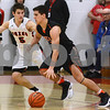 DeKalb senior Derek Kyler tries to get past Yorville's Logan Habada during their game Friday, Feb. 24 at Yorkville High School.<br /> Mark Busch - mbusch@shawmedia.com