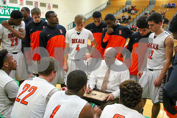 Sam Buckner for Shaw Media.<br /> Head Coach Al Biancalana goes over a play during a timeout in the 4th quarter against Glenbard East on Monday February 27, 2017.