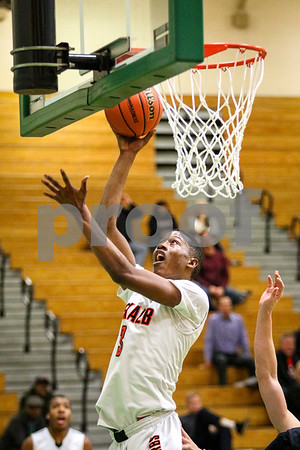 Sam Buckner for Shaw Media.<br /> Darvon Sisson puts up a layup in the regional game against Glenbard East on Monday February 27, 2017.