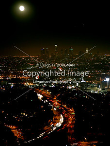 LA city lights, full moon and tail lights on the 101 Hollywood freeway- taken from Mulholland Drive