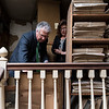 Lynn Mayor Thomas M. McGee tours the attics in the Lynn Public Library with ynn Public Library Chief Librarian Theresa Hurley.