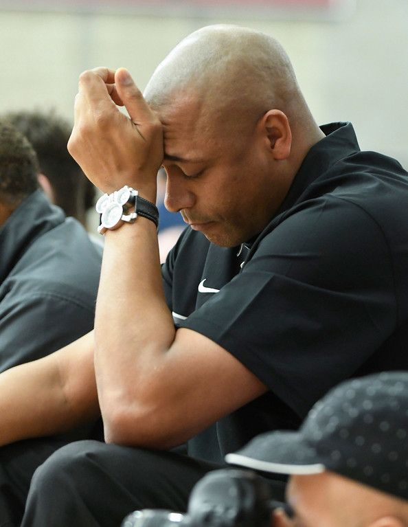 . Ex-UCLA player, Charles O\'Bannon watches from the sidelines as his son\'s team, Bishop Gorman, is dominated early in the game against Sierra Canyon.   (Photo by Michael Kitada)