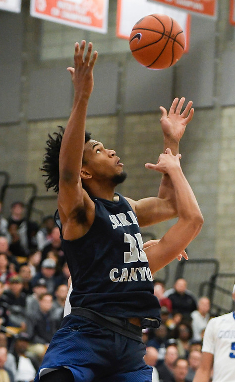 . Sierra Canyon\'s Marvin Bagley III fights for a rebound early in this team\'s game against Bishop Gorman of Nevada.   (Photo by Michael Kitada)