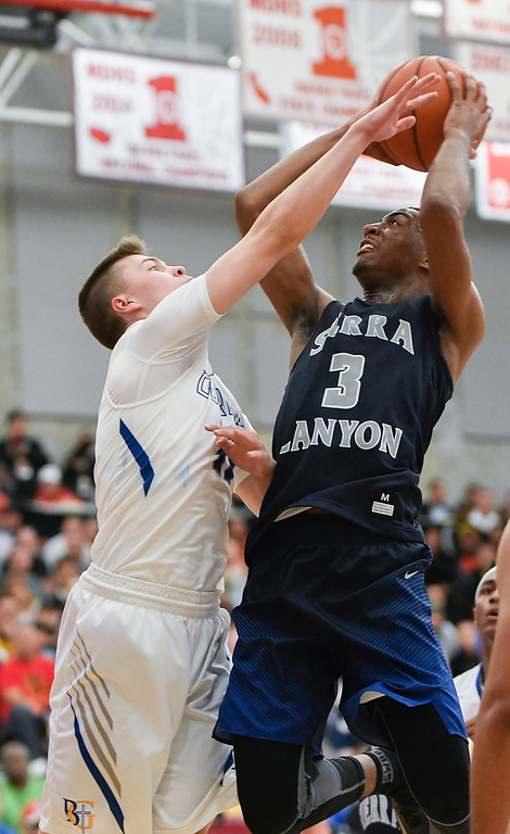 . Sierra Canyon\'s Terrance McBride, right, is defended closely by Bishop Gorman\'s Chance Michaels, left, as he attempts to shoot.   (Photo by Michael Kitada)