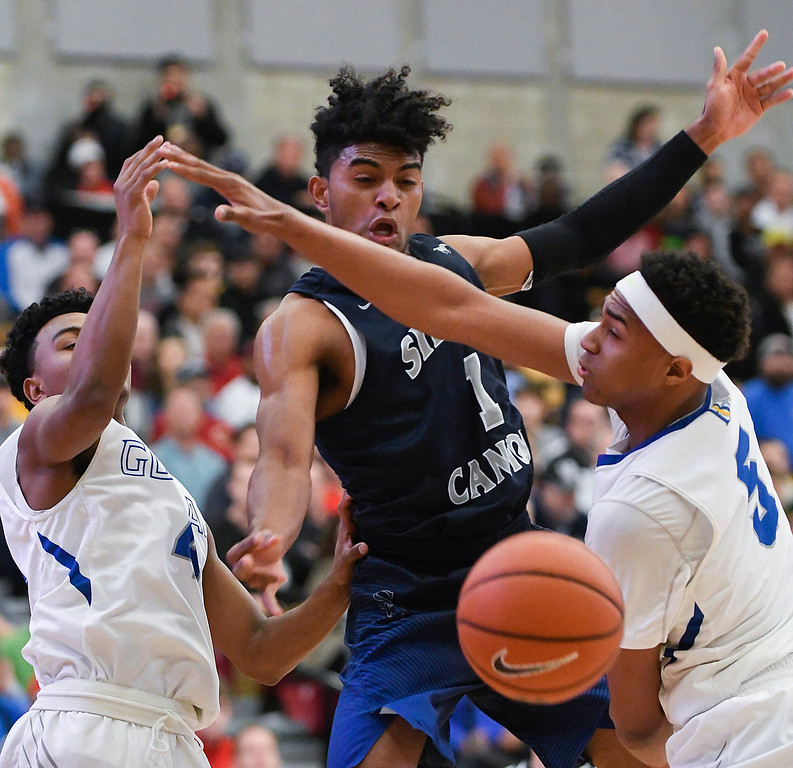 . Sierra Canyon\'s Remy Martin, center, fights the Bishop Gorman defense during their game at the Nike Extravaganza XXII at Mater Dei High School in Santa Ana.   (Photo by Michael Kitada)