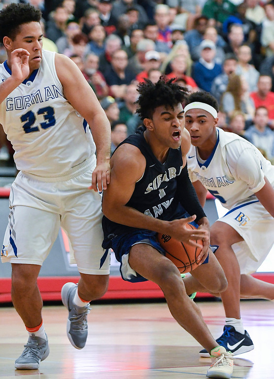 . Sierra Canyon\'s Remy Martin, center, loses the ball as defenders from Bishop Gorman apply pressure.   (Photo by Michael Kitada)