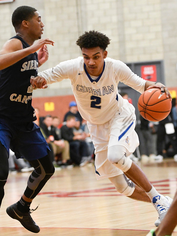 . Bishop Gorman\'s Jamal Bey, right, attempts to dribble past Sierra Canyon\'s Terrance McBride, left, at the Nike Extravaganza XXII at Mater Dei High School in Santa Ana.   (Photo by Michael Kitada)