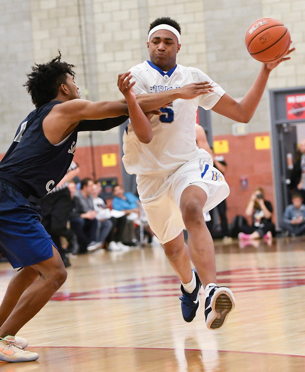. Bishop Gorman\'s Chuck O\'Bannon, right, is tightly defended by Sierra Canyon\'s Remy Martin, left, at the Nike Extravaganza XXII at Mater Dei High School in Santa Ana.   (Photo by Michael Kitada)