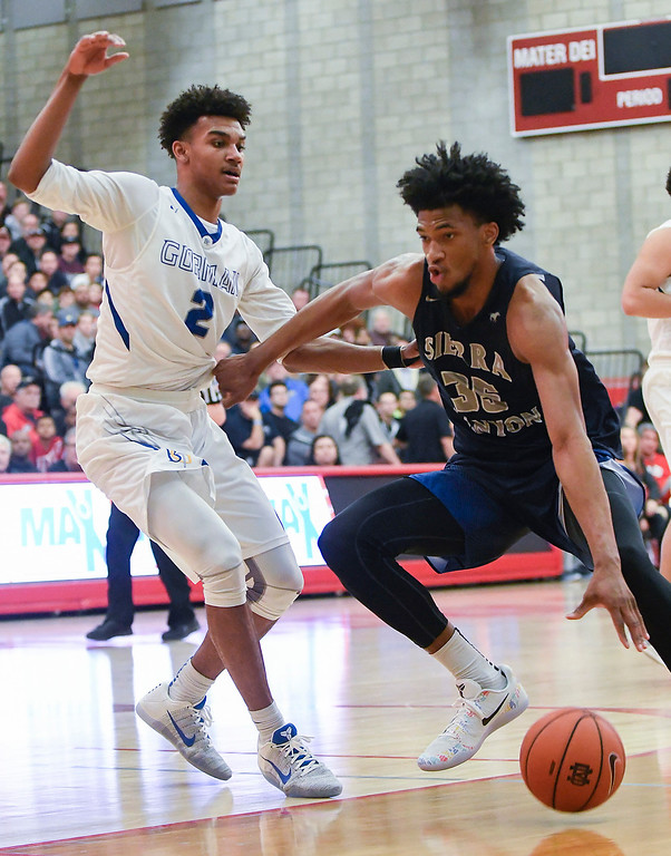 . Sierra Canyon\'s Marvin Bagley III, right, dribbles around Bishop Gorman\'s Jamal Bey, left, during their game at the Nike Extravaganza XXII at Mater Dei High School in Santa Ana.   (Photo by Michael Kitada)