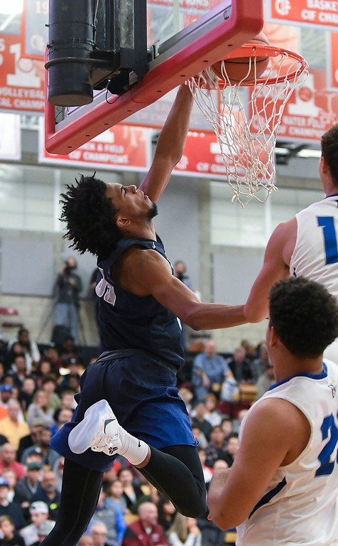 . Sierra Canyon\'s Marvin Bagley III scores on a reverse slam dunk early in the game against Bishop Gorman of Nevada.   (Photo by Michael Kitada)