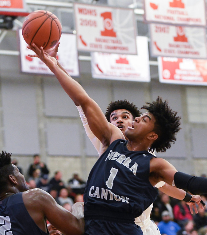 . Sierra Canyon\'s Remy Martin lays up the ball for an easy score during his team\'s game against Bishop Gorman.   (Photo by Michael Kitada)