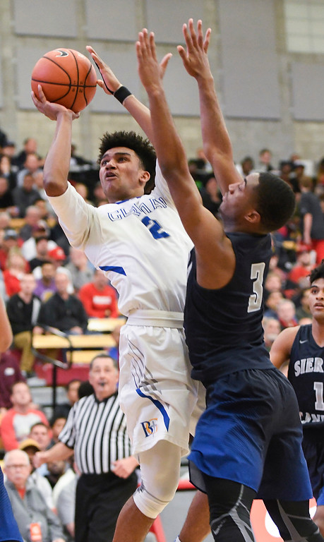 . Bishop Gorman\'s Jamal Bey, left, shoots around the defense of Sierra Canyon\'s Terrance McBride, right, at the Nike Extravaganza XXII at Mater Dei High School in Santa Ana.   (Photo by Michael Kitada)