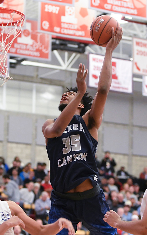 . Sierra Canyon\'s Marvin Bagley III scores from the paint against the team from Bishop Gorman at the Nike Extravaganza XXII at Mater Dei High School in Santa Ana.   (Photo by Michael Kitada)