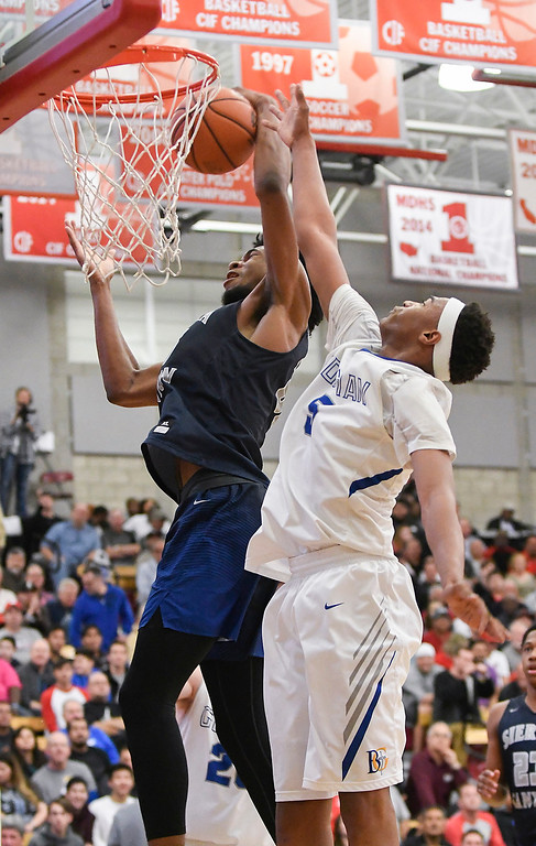 . Sierra Canyon\'s Marvin Bagley III, left, and Bishop Gorman\'s Chuck O\'Bannon, right, battle under the basket at the Nike Extravaganza XXII at Mater Dei High School in Santa Ana.   (Photo by Michael Kitada)