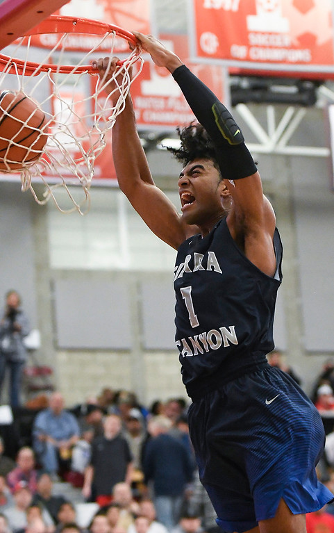 . Sierra Canyon\'s Remy Martin screams as he scores on a slam dunk at the Nike Extravaganza XXII at Mater Dei High School in Santa Ana.   (Photo by Michael Kitada)