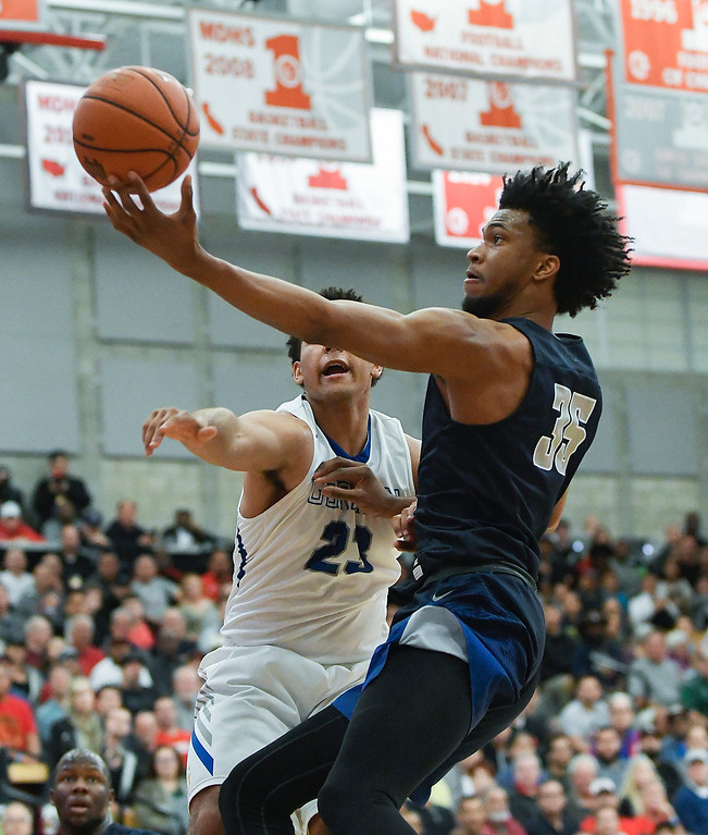 . Sierra Canyon\'s Marvin Bagley III puts a soft touch on the ball as he scores against Bishop Gorman at the Nike Extravaganza XXII at Mater Dei High School in Santa Ana.   (Photo by Michael Kitada)