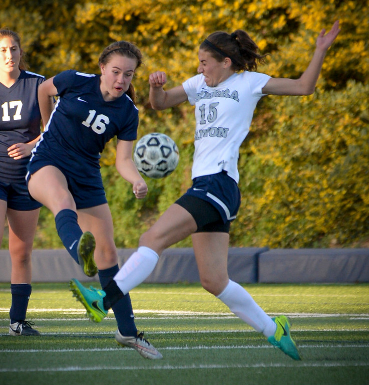 . Sierra Canyon�s Brittany Sacks, #15, pushes the ball into Viewpoint territory as Viewpoint\'s Sarah Konopaske, #16, defends during game action at Sierra Canyon Thursday, March 9, 2017.  Sierra Canyon defeated Viewpoint 3-0.    (Photo by David Crane, Los Angeles Daily News/SCNG)