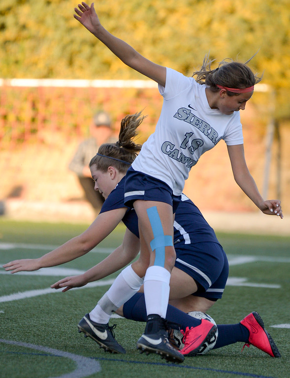 . Sierra Canyon�s Tatum Solis, #18, and Viewpoint\'s Kat Ulich, #10, collide going after the ball during game action at Sierra Canyon Thursday, March 9, 2017.  Sierra Canyon defeated Viewpoint 3-0.    (Photo by David Crane, Los Angeles Daily News/SCNG)