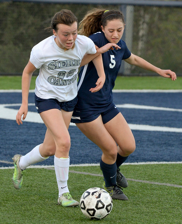 . Sierra Canyon�s Jazy Campbell, #22, and Viewpoint\'s Maddi Jacobs, #5, lock arms going after the ball during game action at Sierra Canyon Thursday, March 9, 2017.  Sierra Canyon defeated Viewpoint 3-0.    (Photo by David Crane, Los Angeles Daily News/SCNG)