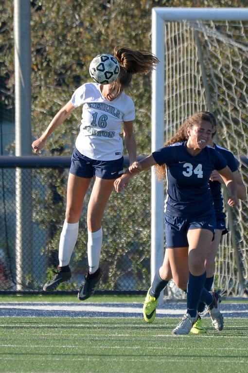 . Sierra Canyon�s Brooke Golik, #16, takes the header as Viewpoint\'s Sophia Stills, #34, defends during game action at Sierra Canyon Thursday, March 9, 2017.  Sierra Canyon defeated Viewpoint 3-0.    (Photo by David Crane, Los Angeles Daily News/SCNG)