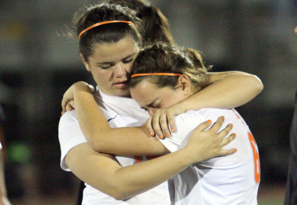 . St. Joseph\'s Olivia Dobbs (18), left, consoles Bianca Lozano (6), right, after losing Saturday evening\'s CIF-SS Division 3 Girls\' Soccer Championship game to Oaks Christian 2-0 at Warren High School in Downey, CA Saturday, March 8, 2014. (Photo by Mark Dustin for the Press Telegram)