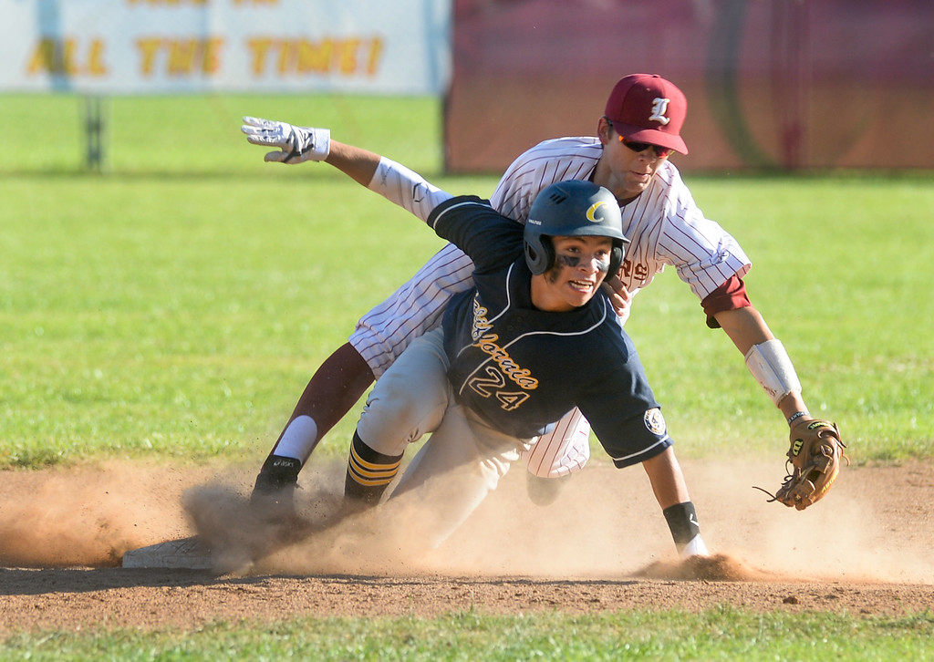 . La Serna shortstop Diego Perez (3) covers second base as California\'s Fernando Morquecho (24) slides in safely in their Del Rio League game at La Serna High School in Whittier on Wednesday April 5, 2017. (Photo by Keith Durflinger/Whittier Daily News/SCNG)