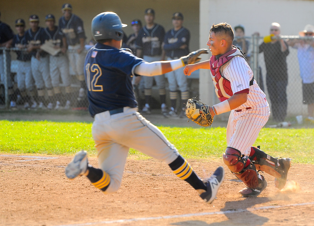 . California\'s Gilly Rodriguez (12) scores on a bunt in front of La Serna catcher Benny Perucho (14) in their Del Rio League game at La Serna High School in Whittier on Wednesday April 5, 2017. (Photo by Keith Durflinger/Whittier Daily News/SCNG)