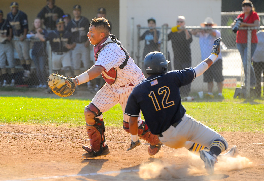 . California\'s Gilly Rodriguez (12) scores on a bunt behind La Serna catcher Benny Perucho (14) in their Del Rio League game at La Serna High School in Whittier on Wednesday April 5, 2017. (Photo by Keith Durflinger/Whittier Daily News/SCNG)