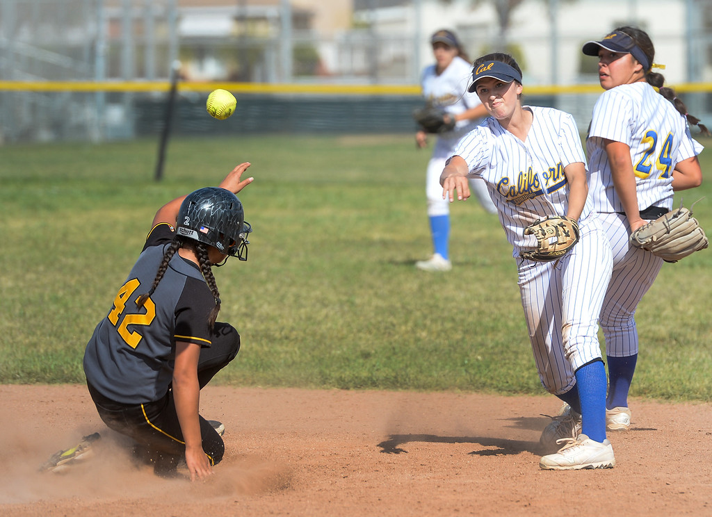 . California shortstop Marina Tamayo (1) forces out Santa Fe\'s Samantha Mancillas (42) at second base and tries for a double play in their Del Rio League girls softball game at Santa Fe High School in Santa Fe Springs on Thursday April 13, 2017. California defeated Santa Fe 11-8. (Photo by Keith Durflinger/Whittier Daily News/SCNG)