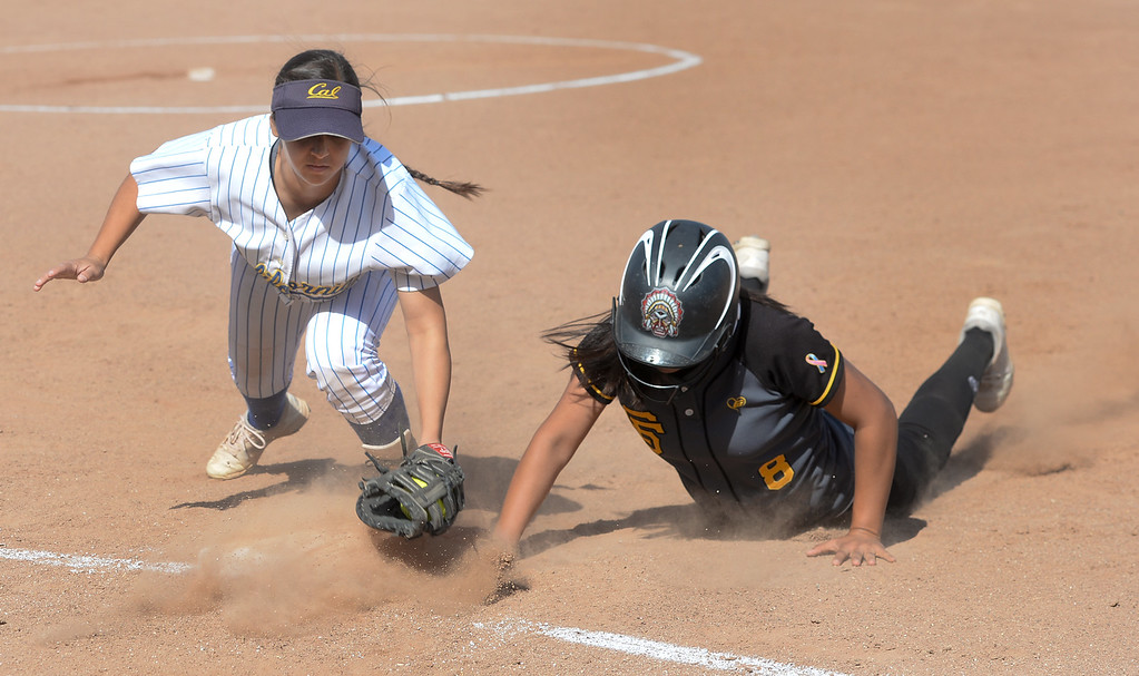 . California first baseman Marissa Montesdeoca (10) tries to tag Santa Fe\'s Baylee Ledesma (8) at first base in their Del Rio League girls softball game at Santa Fe High School in Santa Fe Springs on Thursday April 13, 2017. California defeated Santa Fe 11-8. (Photo by Keith Durflinger/Whittier Daily News/SCNG)