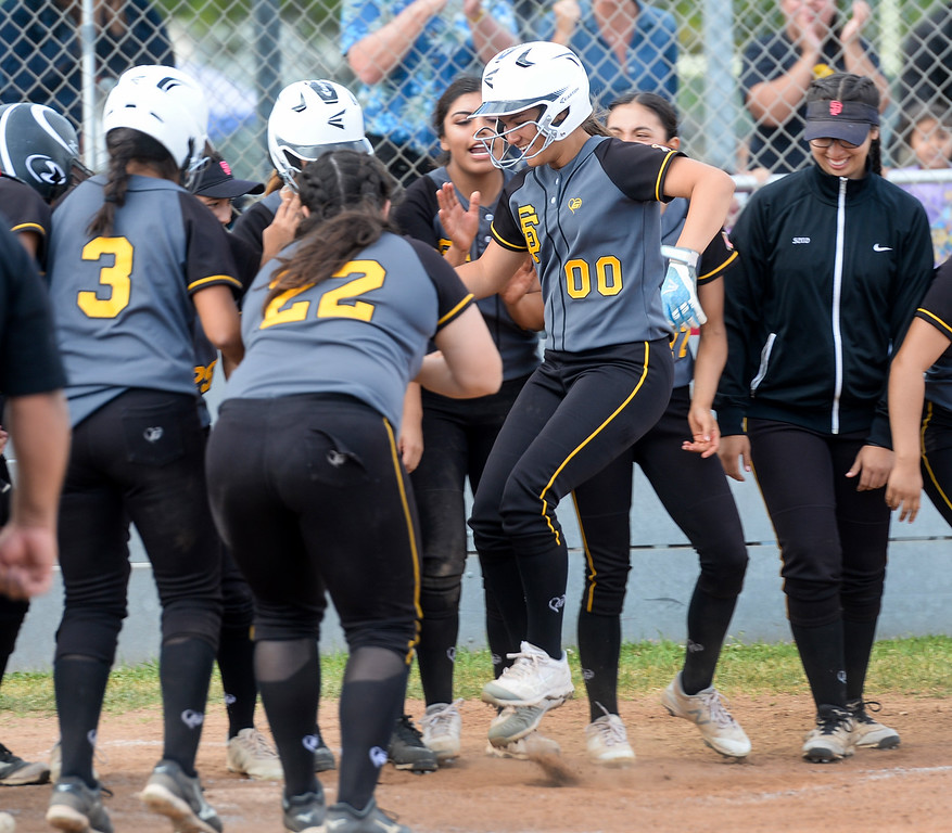 . Santa Fe\'s Maiya Lopez (00) is congratulated after hitting a three-run home run as they play California in their Del Rio League girls softball game at Santa Fe High School in Santa Fe Springs on Thursday April 13, 2017. California defeated Santa Fe 11-8. (Photo by Keith Durflinger/Whittier Daily News/SCNG)