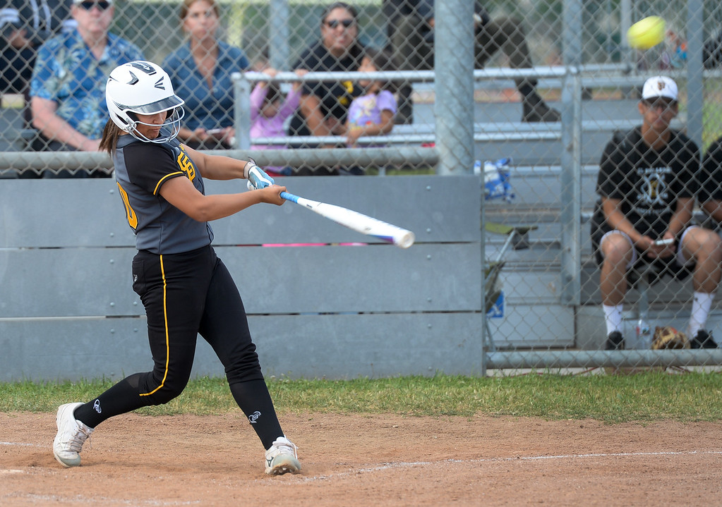 . Santa Fe\'s Maiya Lopez (00) hits a three-run home run as they play California in their Del Rio League girls softball game at Santa Fe High School in Santa Fe Springs on Thursday April 13, 2017. California defeated Santa Fe 11-8. (Photo by Keith Durflinger/Whittier Daily News/SCNG)