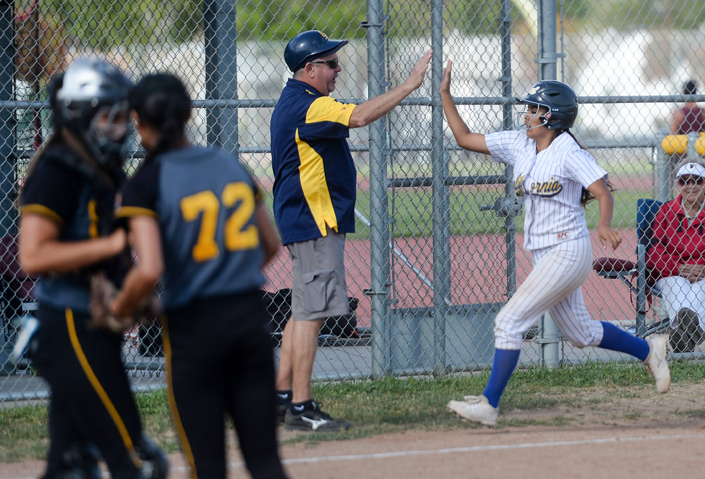 . California\'s Jaclyn Macias (5) gets a high-five from head coach Jim Kruse after hitting a home run in their Del Rio League girls softball game at Santa Fe High School in Santa Fe Springs on Thursday April 13, 2017. California defeated Santa Fe 11-8. (Photo by Keith Durflinger/Whittier Daily News/SCNG)