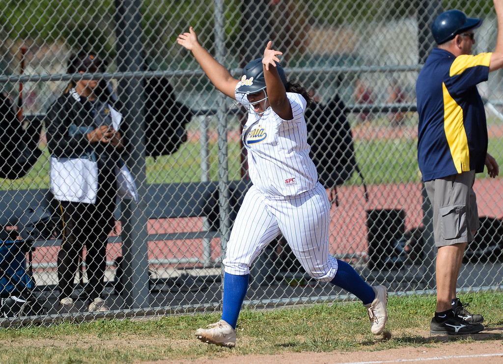 . California\'s Amanda Cabral (15) hits a home run as they play Santa Fe in their Del Rio League girls softball game at Santa Fe High School in Santa Fe Springs on Thursday April 13, 2017. California defeated Santa Fe 11-8. (Photo by Keith Durflinger/Whittier Daily News/SCNG)