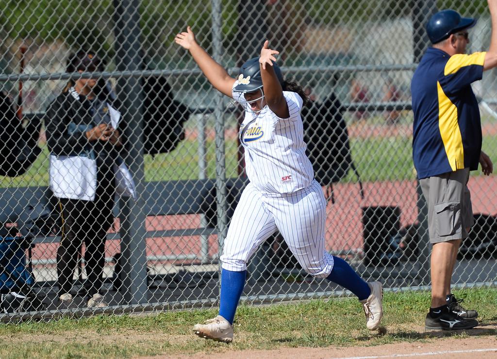 . California\'s Amanda Cabral (15) hits a home run as they play Santa Fe in their Del Rio League girls softball game at Santa Fe High School in Santa Fe Springs on Thursday April 13, 2017. California defeated Santa Fe 11-8. (Photo by Keith Durflinger/Whittier Daily News/SCNG)