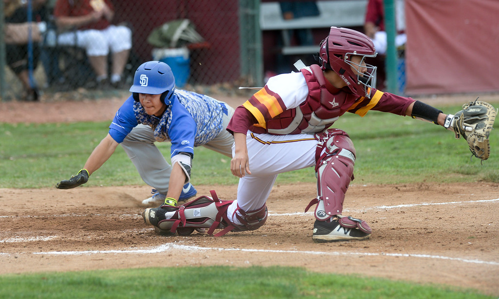 . Wilson catcher Mat Orozco (55) receives the ball late as San Dimas\' Jalen Guzman (2) scores in their Valle Vista league baseball game at Wilson High School in Hacienda Heights on Tuesday April 18, 2017. (Photo by Keith Durflinger/Whittier Daily News/SCNG)