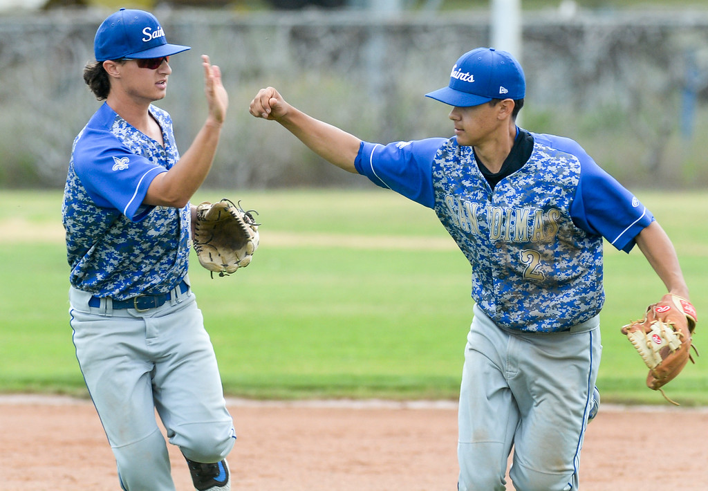 . San Dimas shortstop Joseph Bahna (14) congratulates second baseman Jalen Guzman (2) after picking off a Wilson player in their Valle Vista league baseball game at Wilson High School in Hacienda Heights on Tuesday April 18, 2017. (Photo by Keith Durflinger/Whittier Daily News/SCNG)