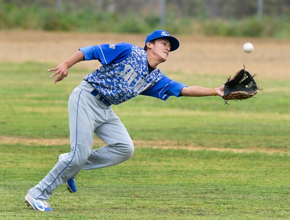 . San Dimas right fielder Art Ruiz (5) runs down a fly ball in their Valle Vista league baseball game at Wilson High School in Hacienda Heights on Tuesday April 18, 2017. (Photo by Keith Durflinger/Whittier Daily News/SCNG)