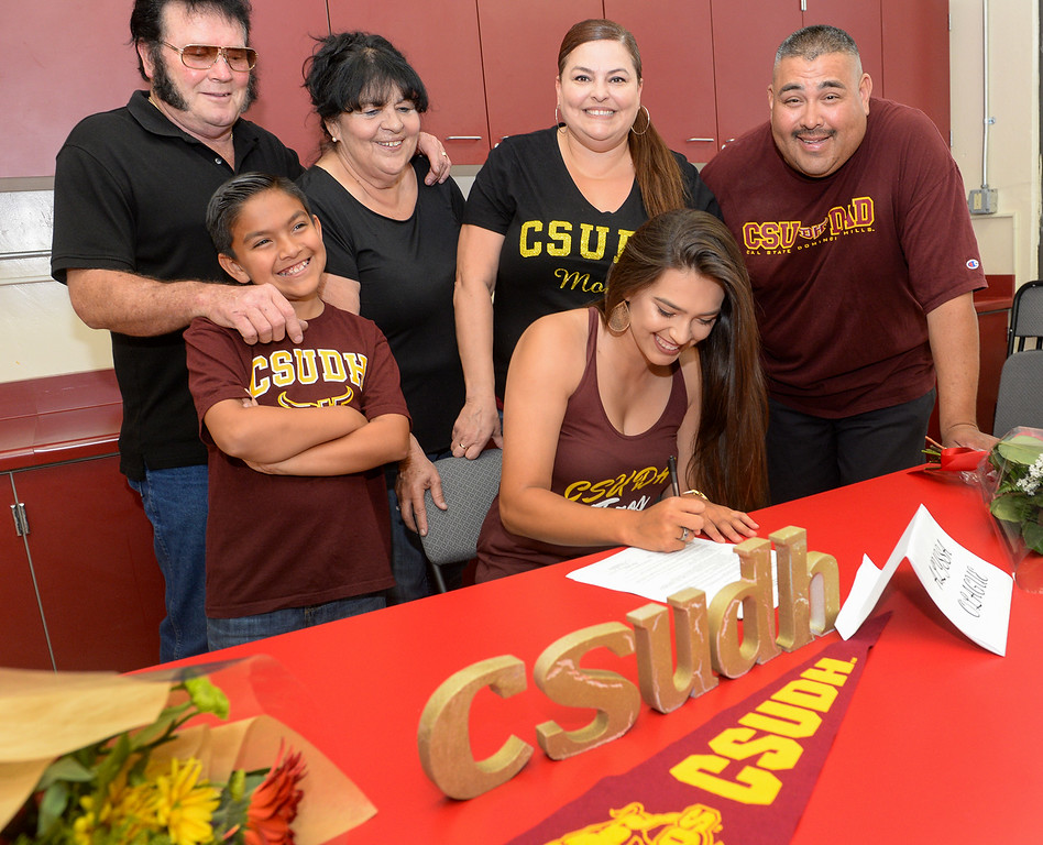 . Softball player Alyssa Olague signs her letter of intent with Cal State Dominguez Hills during a ceremony with her family from left, Jacob Olague, 9, grandparents Lloyd Bradshaw and Joyce Calderon, and her parents Stephanie and Daniel Olague at Whittier High School in Whittier on Tuesday April 18, 2017. (Photo by Keith Durflinger/Whittier Daily News/SCNG)