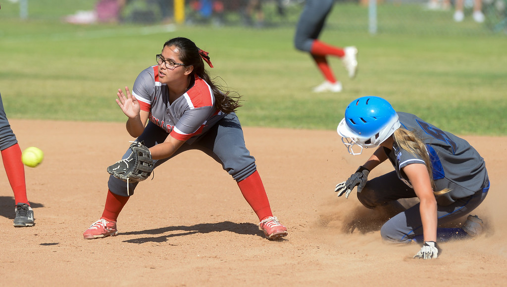 . La Habra\'s Kira Cauley slides in safely at second base as Fullerton second baseman Mayra Encinas (44) applies a late tag in their Freeway League girls softball game at La Habra High School in La Habra on Thursday April 20, 2017. La Habra defeated Fullerton 12-0. (Photo by Keith Durflinger/Whittier Daily News/SCNG)