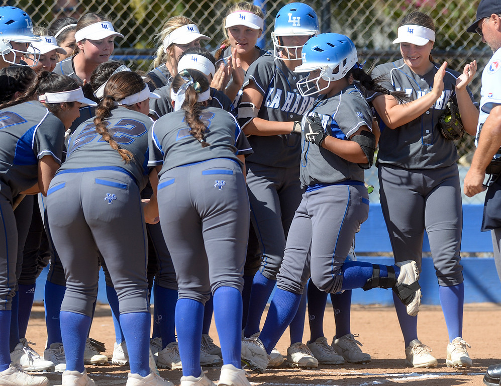 . La Habra players greet Maritza Diaz (1) after hitting a home run in the second inning as they play Fullerton in their Freeway League girls softball game at La Habra High School in La Habra on Thursday April 20, 2017. La Habra defeated Fullerton 12-0. (Photo by Keith Durflinger/Whittier Daily News/SCNG)