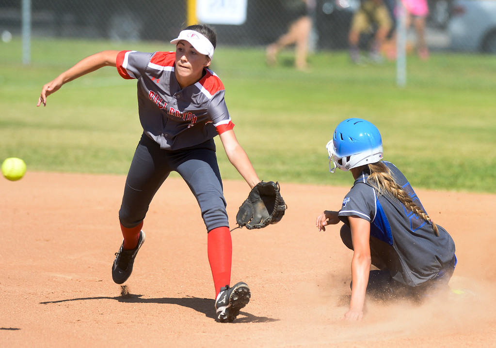 . La Habra\'s Kira Cauley (5) slides in safely as Fullerton\'s Amanda Pacillas (3) reaches for the wide throw in their Freeway League girls softball game at La Habra High School in La Habra on Thursday April 20, 2017. La Habra defeated Fullerton 12-0. (Photo by Keith Durflinger/Whittier Daily News/SCNG)