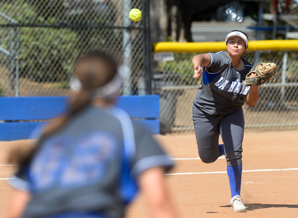 . La Habra third baseman Anissa Alatorre (77) throws the runner out at first base as they play Fullerton in their Freeway League girls softball game at La Habra High School in La Habra on Thursday April 20, 2017. La Habra defeated Fullerton 12-0. (Photo by Keith Durflinger/Whittier Daily News/SCNG)