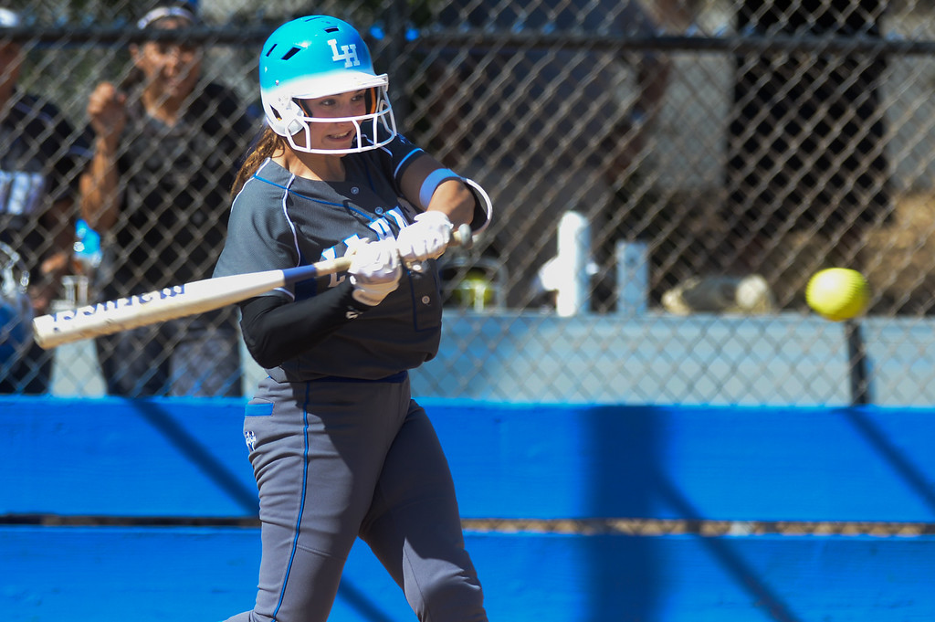. La Habra\'s Hannah Johnson (25) hits a solo home run in the second inning as they play Fullerton in their Freeway League girls softball game at La Habra High School in La Habra on Thursday April 20, 2017. La Habra defeated Fullerton 12-0. (Photo by Keith Durflinger/Whittier Daily News/SCNG)