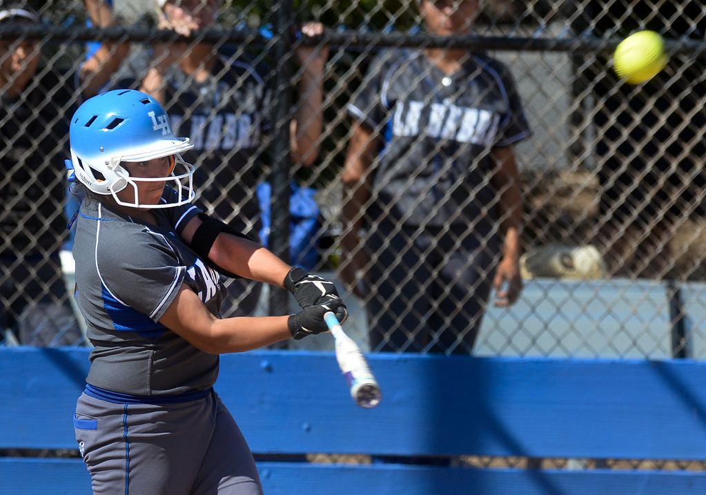 . La Habra\'s Maritza Diaz (1) hits a home run in the second inning as they play Fullerton in their Freeway League girls softball game at La Habra High School in La Habra on Thursday April 20, 2017. La Habra defeated Fullerton 12-0. (Photo by Keith Durflinger/Whittier Daily News/SCNG)