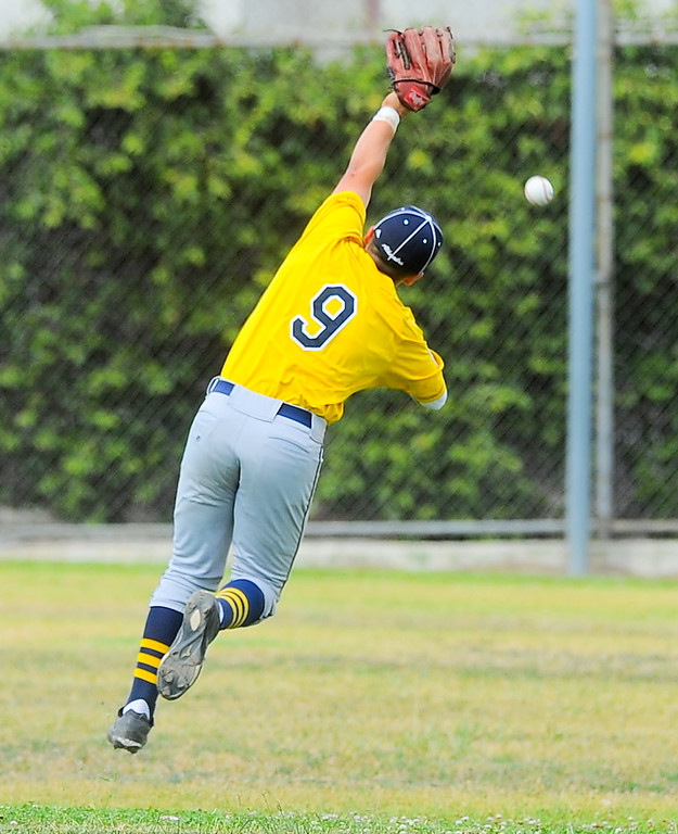 . Alhambra\'s Jake Sanchez (9) leaps trying to get a bloop hit in their Almont League baseball game at Schurr High School in Montebello on Tuesday April 25, 2017. (Photo by Keith Durflinger/Whittier Daily News/SCNG)