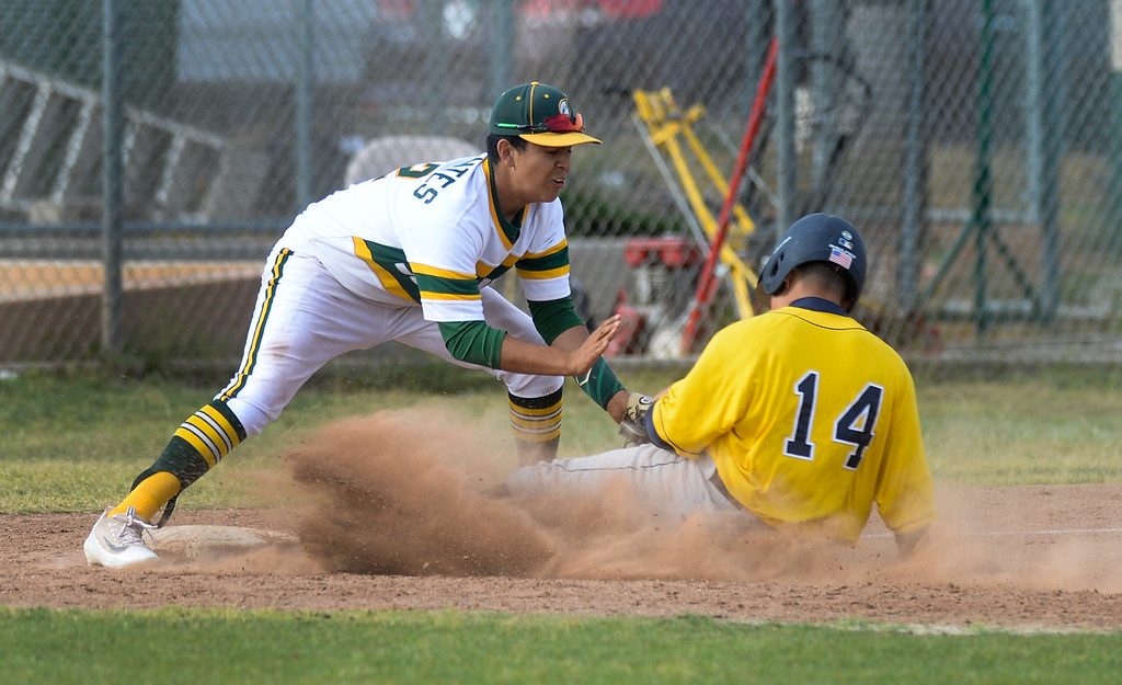 . Schurr third baseman Justin Cervantes (42) tags out Alhambra\'s Xavier Perez (14) sliding into third base in their Almont League baseball game at Schurr High School in Montebello on Tuesday April 25, 2017. (Photo by Keith Durflinger/Whittier Daily News/SCNG)